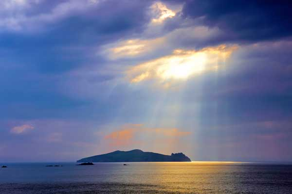 Sunlight breaking through the clouds on the Dingle Peninsula in Ireland