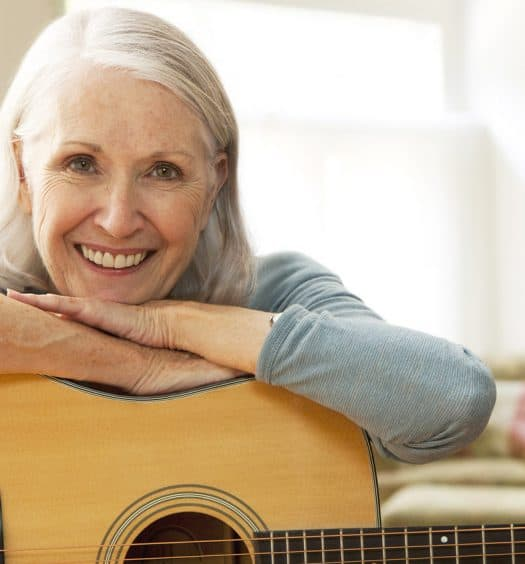 Senior woman learning a musical instrument