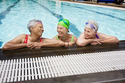 Smiling senior women swimming