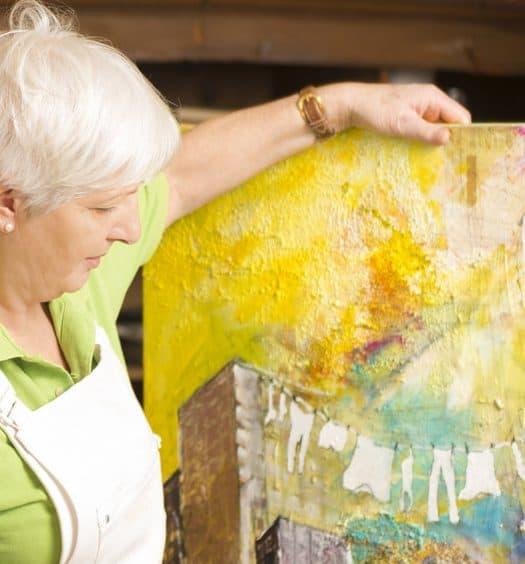 senior woman painting artist