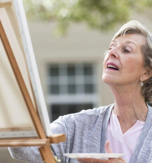 Senior woman painting