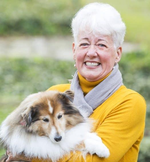 Senior woman having a dog