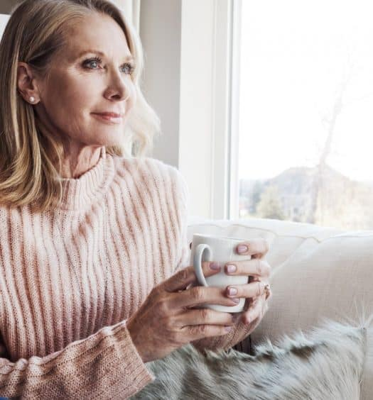 Beautiful Mature Woman Drinking Tea