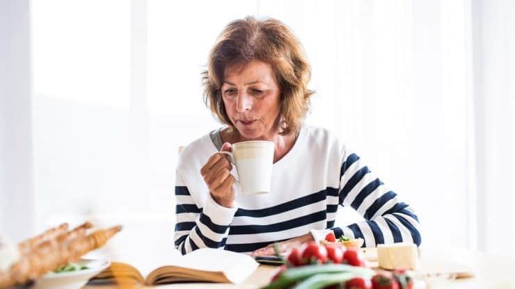 senior woman eating alone at home.
